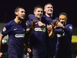 Southend's Ryan Leonard celebrates with teammates after scoring his team's fourth goal against Millwall during their FA Cup third round match on January 4, 2013