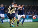 Rochdale's Scott Hogan and Leeds' Jason Pearce battle for the ball during their FA Cup third round match on January 4, 2013