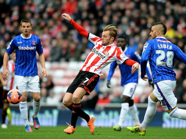 Sebastian Larsson of Sunderland controls the ball iunder pressure from Max Ehmer of Calisle during the Budweiser FA Cup third round match on January 5, 2014