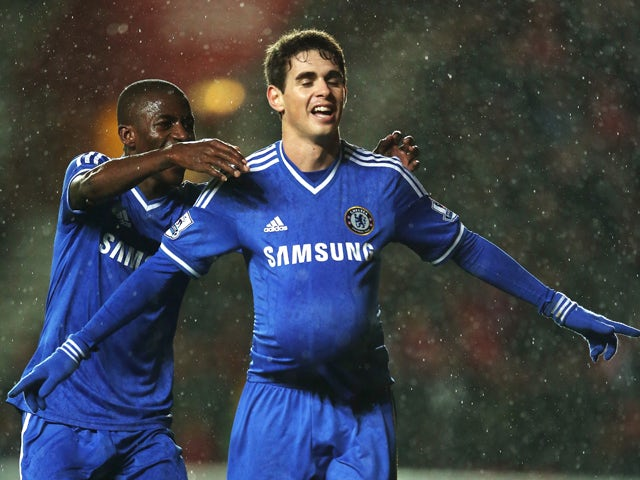Oscar of Chelsea celebrates with teammate Ramires after scoring his team's third goal during the Barclays Premier League match between Southampton and Chelsea at St Mary's Stadium on January 1, 2014