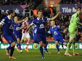 Leighton Baines of Everton celebrates scoring the equaliser from the penalty spot during the Barclays Premier League match between Stoke City and Everton at Britannia Stadium on January 01, 2014