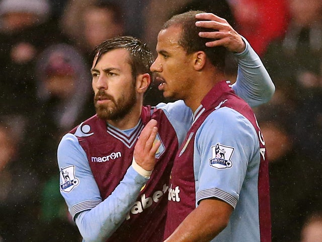 Aston Villas English striker Gabriel Agbonlahor is congratulated by Aston Villas Spanish defender Antonio Luna after scoring the opening goal during the English Premier League football match between Sunderland and Aston Villa at the Stadium of Light in Su
