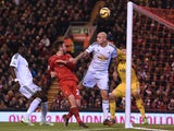 Swansea City's English midfielder Jonjo Shelvey deflects the ball into his own net from a corner for Liverpool's fourth goal during the English Premier League football match between Liverpool and Swansea City at Anfield in Liverpool, north west England, o