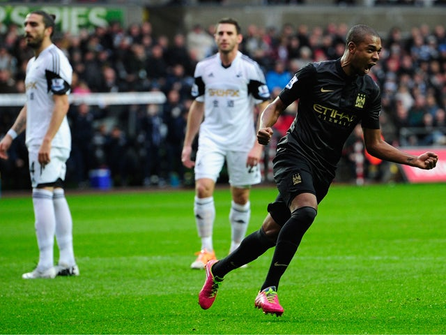 Manchester City player Fernandinho celebrates the opening goal during the Barclays Premier League match between Swansea City and Manchester City at Liberty Stadium on January 1, 2014