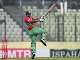 Bangladesh cricketer Tamim Iqbal plays a shot during the fourth one-day international (ODI) match between Bangladesh and Zimbabwe at the Sher-e Bangla National Stadium in Dhaka on November 28, 2014