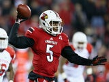 Teddy Bridgewater of the Louisville Cardinals throws a pass during the game against the Houston Cougars at Papa John's Cardinal Stadium on November 16, 2013