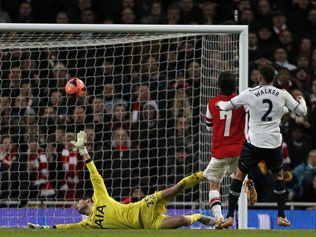 Arsenal's Tomas Rosicky scores his team's second goal against Tottenham during their FA Cup third round match on January 4, 2013