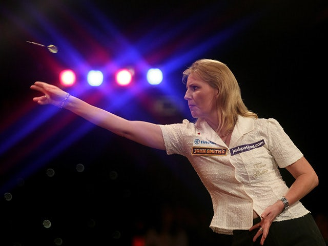 Trina Gulliver in action against Rhian Edwards during the women's final of the Lakeside World Professional Darts Championships on January 7, 2011