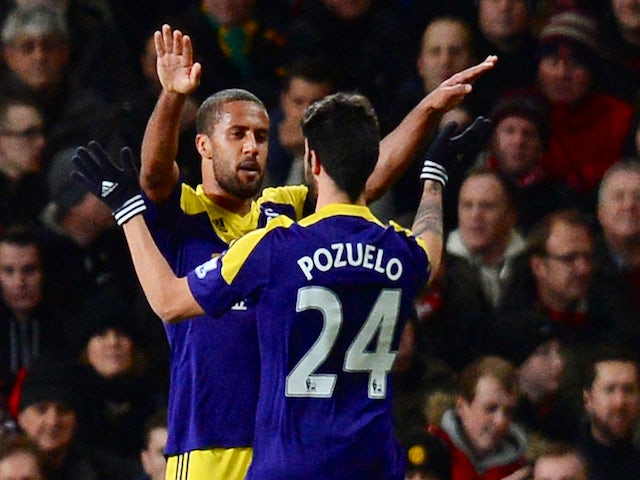 Swansea City's English midfielder Wayne Routledge (2R) celebrates with Swansea City's Spanish midfielder Alejandro Pozuelo (R) after scoring the opening goal against Manchester United on January 5, 2014