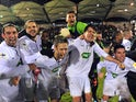 Yzeure players celebrates victory over Lorient after the final whistle during their French Cup match on January 4, 2013
