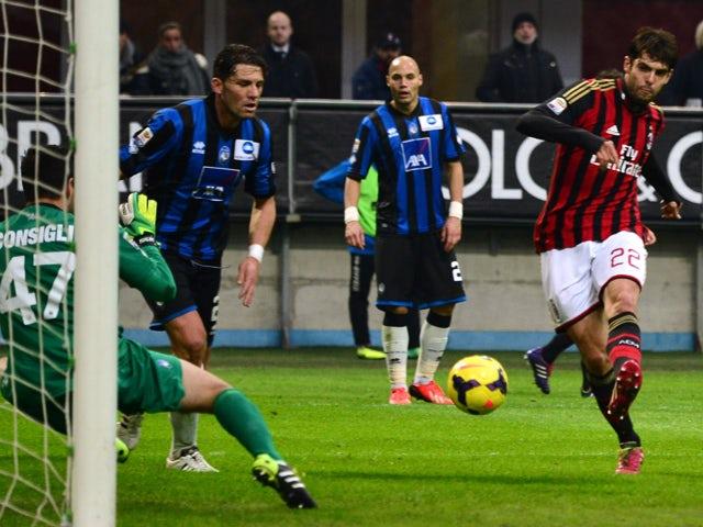 AC Milan's Brazilian forward Kaka kicks and score during the Serie A football match between AC Milan and Atalanta at San Siro Stadium in Milan on January 6, 2014