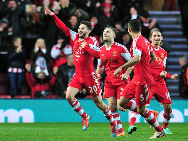 Southampton's English midfielder Adam Lallana (L) celebrates scoring the opening goal of the English Premier League football match between Southampton and West Bromwich Albion on January 11, 2014