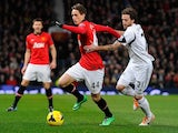 Manchester United's Belgian midfielder Adnan Januzaj (C) vies with Swansea City's Spanish midfielder Jose Canas during the English Premier League football match on January 11, 2014