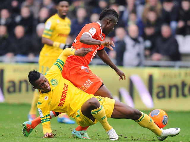 Lorient's Alain Traore and Nantes Birama Toure battle for the ball during their Ligue 1 match on January 12, 2014