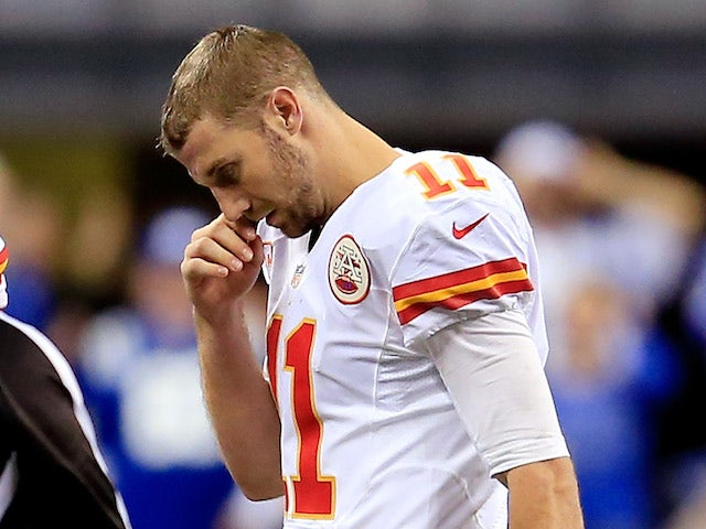 Quarterback Alex Smith #11 of the Kansas City Chiefs walks back to the bench against the Indianapolis Colts during a Wild Card Playoff game on January 4, 2014