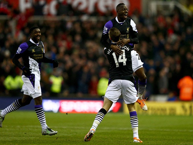 Liverpool's Aly Cissokho celebrates with teammate Jordan Henderson after scoring the opening goal against Stoke during their Premier League match on January 12, 2014