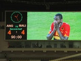 Angola's Zuela is shown on a big screen as he reacts to the 4-4 draw the Group A African Nations Cup match between Angola and Mali, at the November 11 Stadium on January 10, 2010
