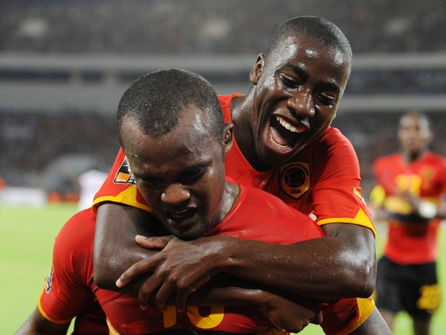 Angola's Flavio celebrates a goal with Djalma Campos during the Group A African Nations Cup match between Angola and Mali, at the November 11 Stadium on January 10, 2010