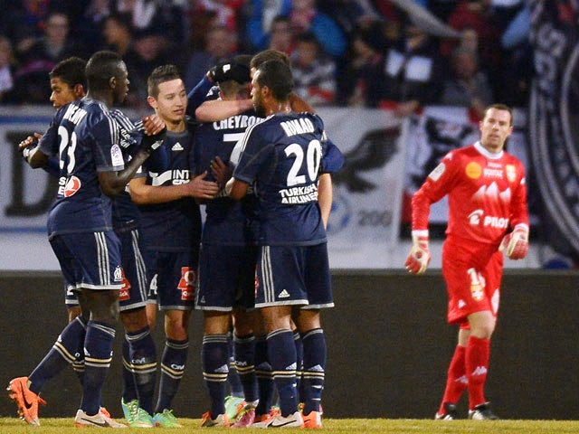 Marseille's Benoit Cheyrou is congratulated by teammates after scoring his team's first goal against Evian during their Ligue 1 match on January 12, 2014