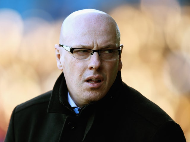 Brian McDermott. manager of Leeds United looks on during the Sky Bet Championship match between Sheffield Wednesday and Leeds United at Hillsborough Stadium on January 11, 2014