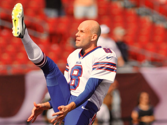 Punter Brian Moorman #8 of the Buffalo Bills warms up for play against the Tampa Bay Buccaneers December 8, 2013