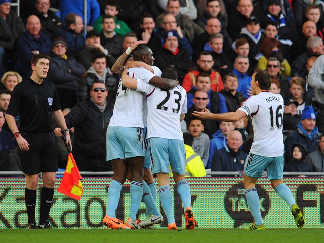 West Ham player Carlton Cole is congratulated after opening the scoring during the Barclays Premier League match between Cardiff City and West Ham United at Cardiff City Stadium on January 11, 2014