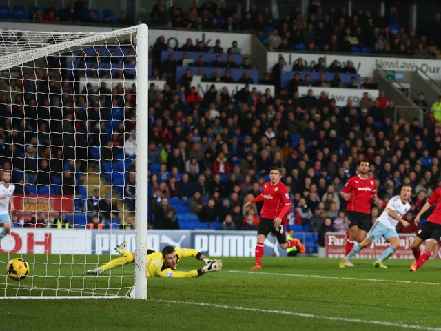 David Marshall the goalkeeper of Cardiff City looks back as a shot from Mark Noble of West Ham United beats him for the second goal during the Barclays Premier League match between Cardiff City and West Ham United at the Cardiff City Stadium on January 11