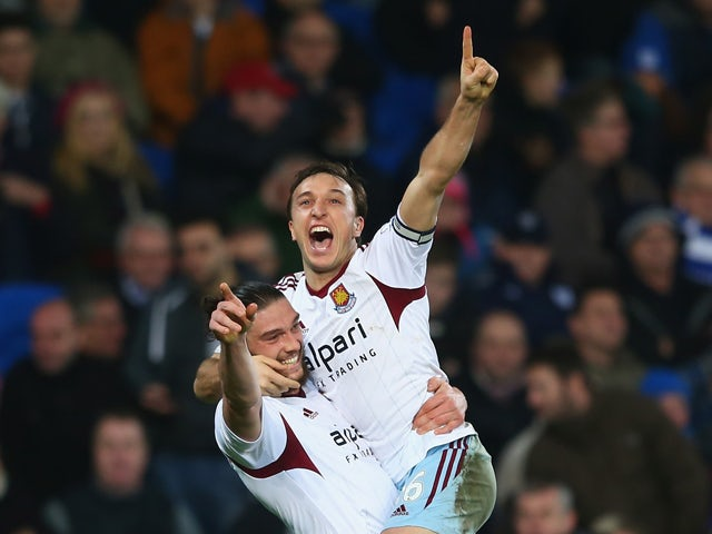 Mark Noble celebrates with Andy Carroll of West Ham United after scoring his sides second goal duering the Barclays Premier League match between Cardiff City and West Ham United at the Cardiff City Stadium on January 11, 2014
