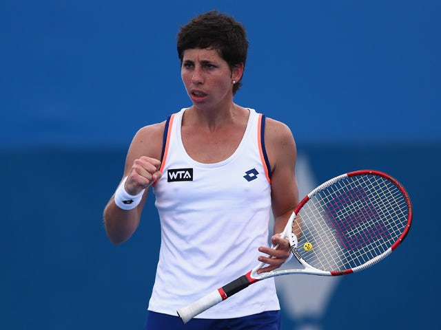 Carla Suarez Navarro of Spain celebrates winning the match against Ekaterina Makarova of Russia during day three of the 2014 Sydney International at Sydney Olympic Park Tennis Centre on January 7, 2014