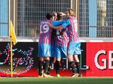 Players of Catania celebrate the opening goal during the Serie A match between Calcio Catania and Bologna FC at Stadio Angelo Massimino on January 6, 2014