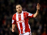 Stoke's Charlie Adam celebrates after scoring his team's second goal against Liverpool during their Premier League match on January 12, 2014