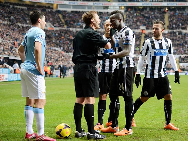 Newcastle's Cheik Tiote argues with referee Mike Jones after his goal is disallowed for offside against Manchester City during their Premier League match on January 12, 2014
