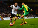 Chris David of Fulham battles with Josh Murphy of Norwich during the FA Cup sponsored by Budweiser Third Round match between Norwich City and Fulham at Carrow Road on January 4, 2014