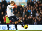 Christian Eriksen of Tottenham Hotspur scores during the Barclays Premier League match between Tottenham Hotspur and Crystal Palace at White Hart Lane on January 11, 2014