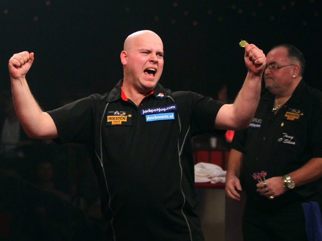 Christian Kist of the Netherlands celebrates after winning the Lakeside World Professional Darts Championship final match played against Tony O'Shea of England at Lakeside, Frimley Green, on January 15, 2012