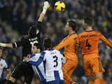 Real Madrid's Portuguese forward Cristiano Ronaldo vies with Espanyol's goalkeeper K. Casilla during the Spanish league football match on January 12, 2014