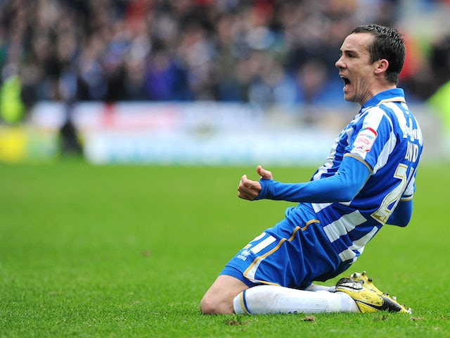 David Lopez of Brighton celebrates scoring the their second goal during the npower Championship match between Brighton & Hove Albion and Crystal Palace on March 17, 2013