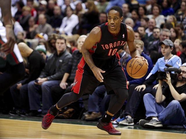 DeMar DeRozan #10 of the Toronto Raptors dribbles the basektball up the court during the game against the Milwaukee Bucks at Bradley Center on November 2, 2013