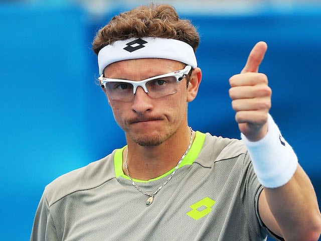 Dennis Istomin of Uzbekistan celebrates victory in his second round match against Marin Cilic of Croatia during day four of the 2014 Sydney International on January 8, 2014