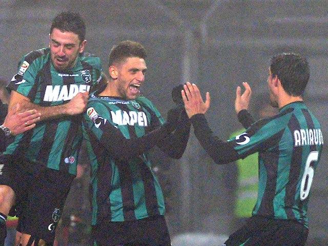 Domenico Berardi of US Sassuolo Calcio #25 celebrates scoring the fourth goal during the Serie A match between US Sassuolo Calcio and AC Milan on January 12, 2014