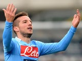 Napoli's Dries Mertens celebrates after scoring the opening goal against Hellas Verona during their Serie A match on January 12, 2014