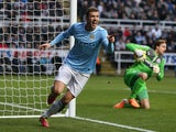 Manchester City's Edin Dzeko celebrates after scoring the opening goal against Newcastle during their Premier League match on January 12, 2014