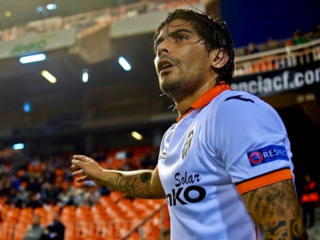 Valencia's Ever Banega in action against Kuban during their Europa League match on December 12, 2013