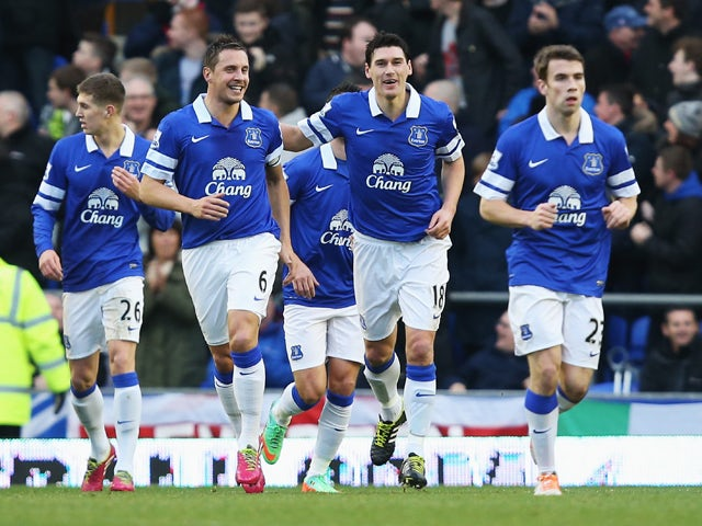 Gareth Barry of Everton celebrates his goal with Phil Jagielka during the Barclays Premier League match between Everton and Norwich City at Goodison Park on January 11, 2014