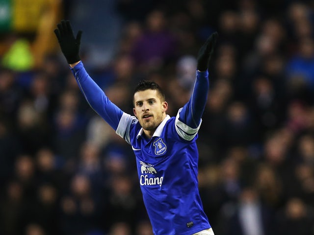 Kevin Mirallas of Everton celebrates his goal during the Barclays Premier League match between Everton and Norwich City at Goodison Park on January 11, 2014