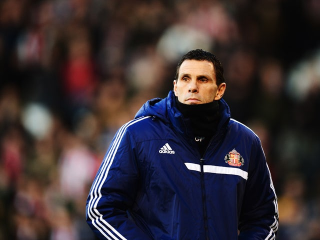 Sunderland manager Gus Poyet looks on before the Barclays Premier League match between Fulham and Sunderland at Craven Cottage on January 11, 2014