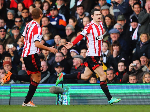 Adam Johnson of Sunderland celebrates scoring with a free kick during the Barclays Premier League match between Fulham and Sunderland at Craven Cottage on January 11, 2014
