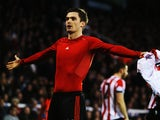Adam Johnson of Sunderland celebrates scoring his sides third goal during the Barclays Premier League match between Fulham and Sunderland at Craven Cottage on January 11, 2014