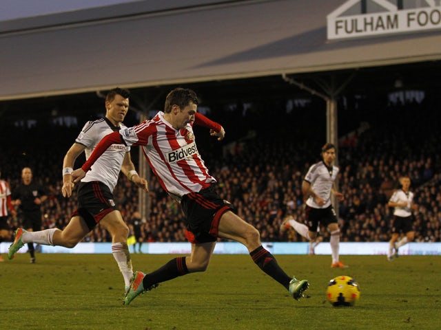 Sunderland's English midfielder Adam Johnson scores his second goal during the English Premier League football match between Fulham and Sunderland at Craven Cottage in London on January 11, 2014