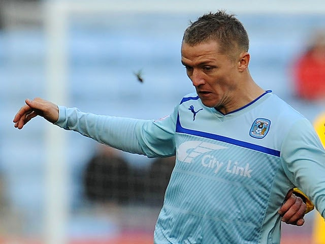 Gary McSheffrey of Coventry City and Ben Farrell of Arlesey Town in action during the FA Cup With Budweiser 1st Round match between Coventry City and Arlesey on November 3, 2012